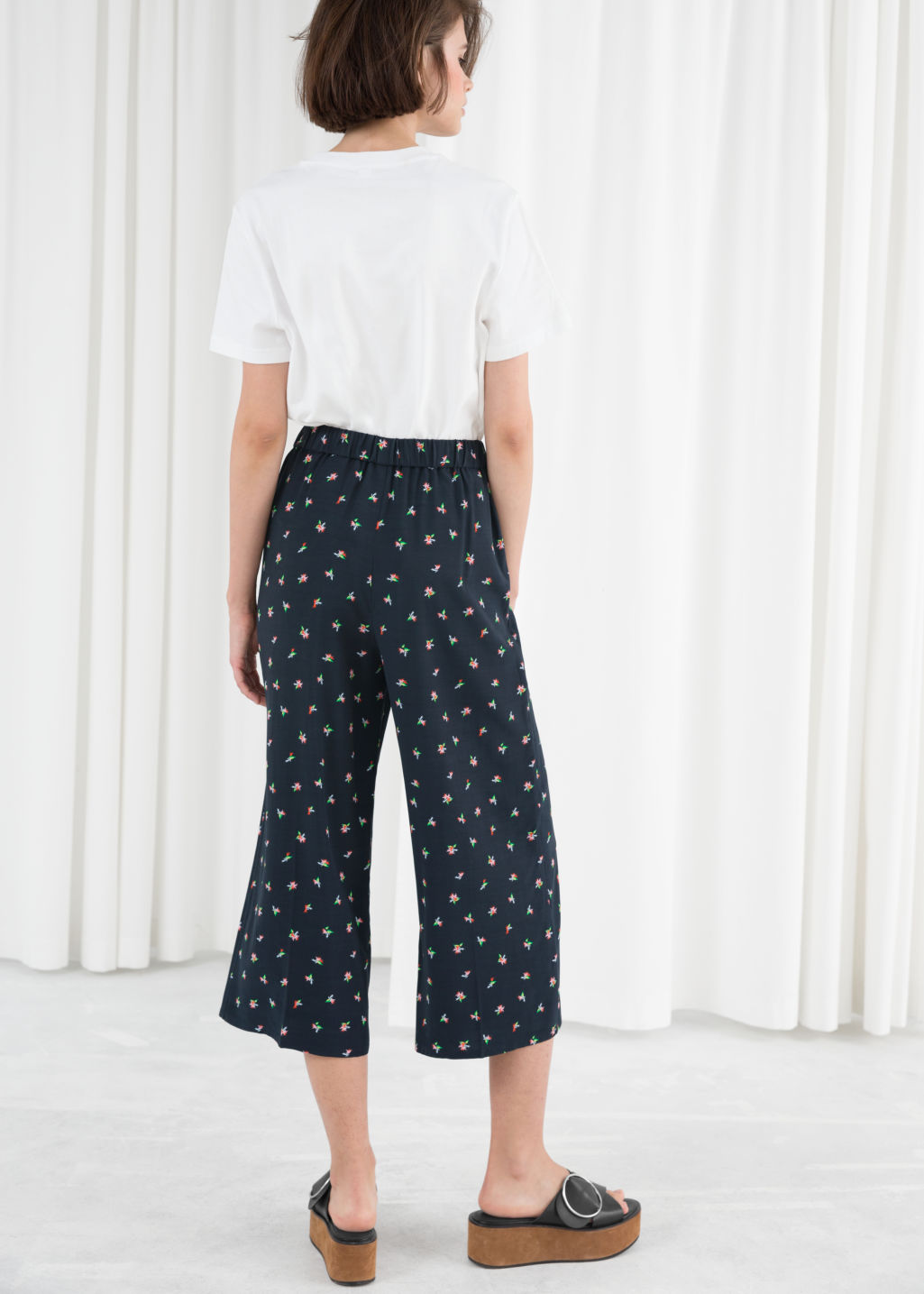 Model back image of Stories high waisted culottes in blue