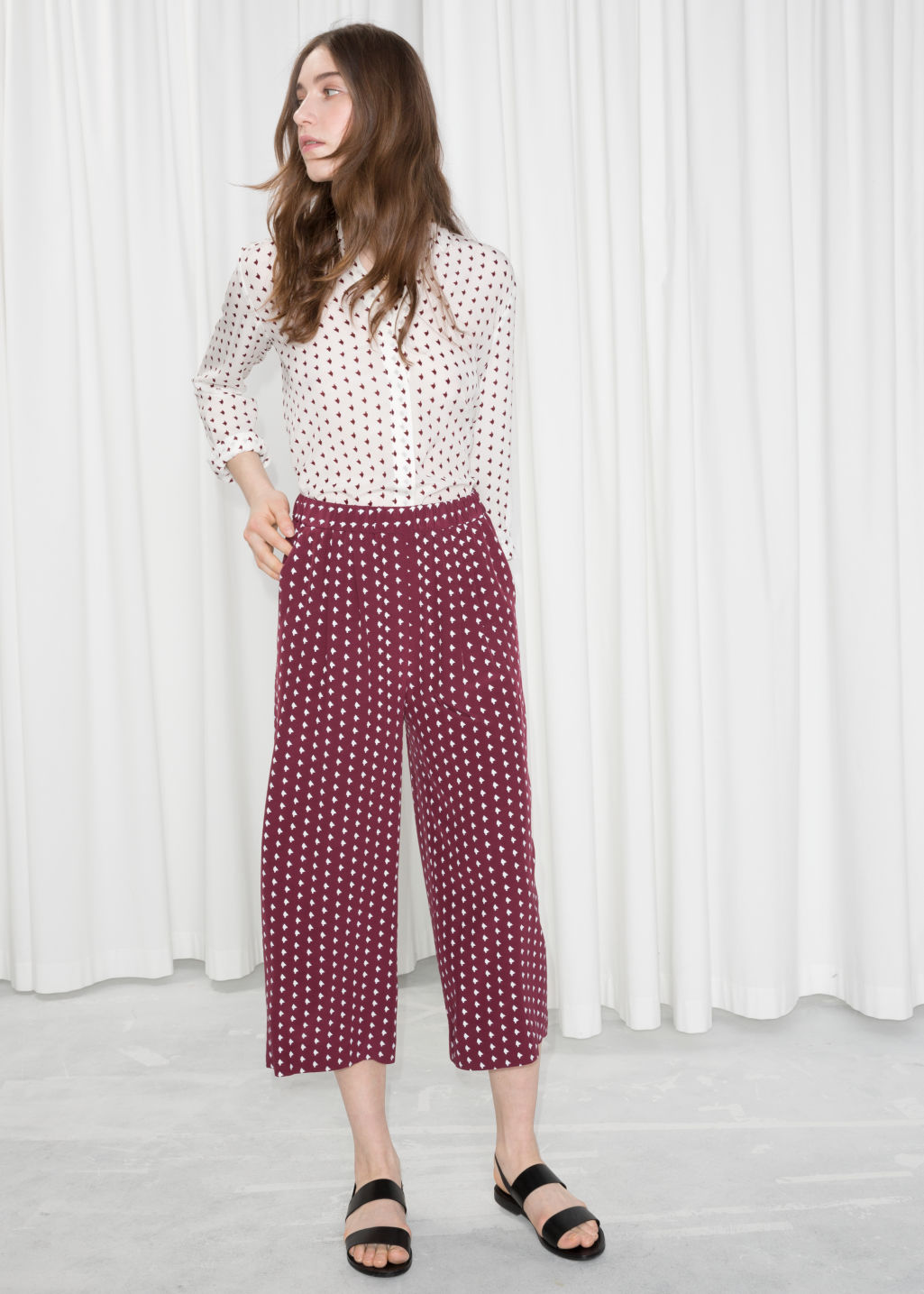 Model front image of Stories printed culottes in red