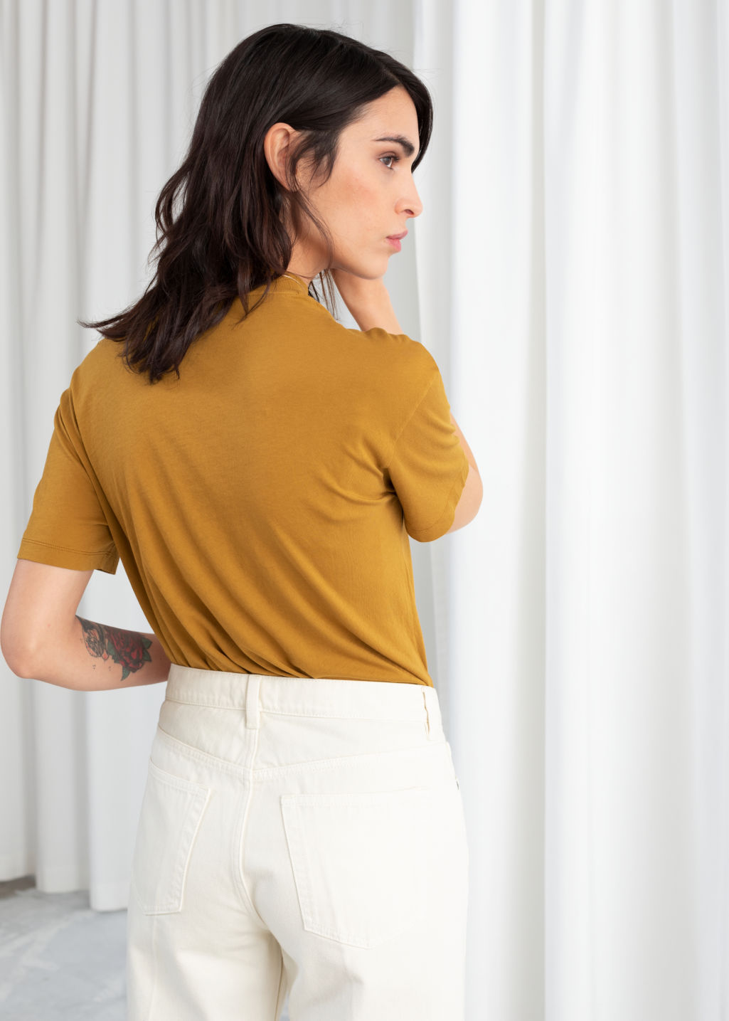 Model back image of Stories mock neck tee in yellow
