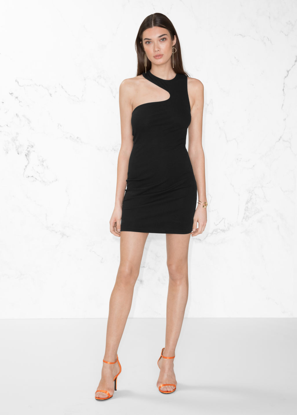 Model front image of Stories asymmetric cut-out dress in black