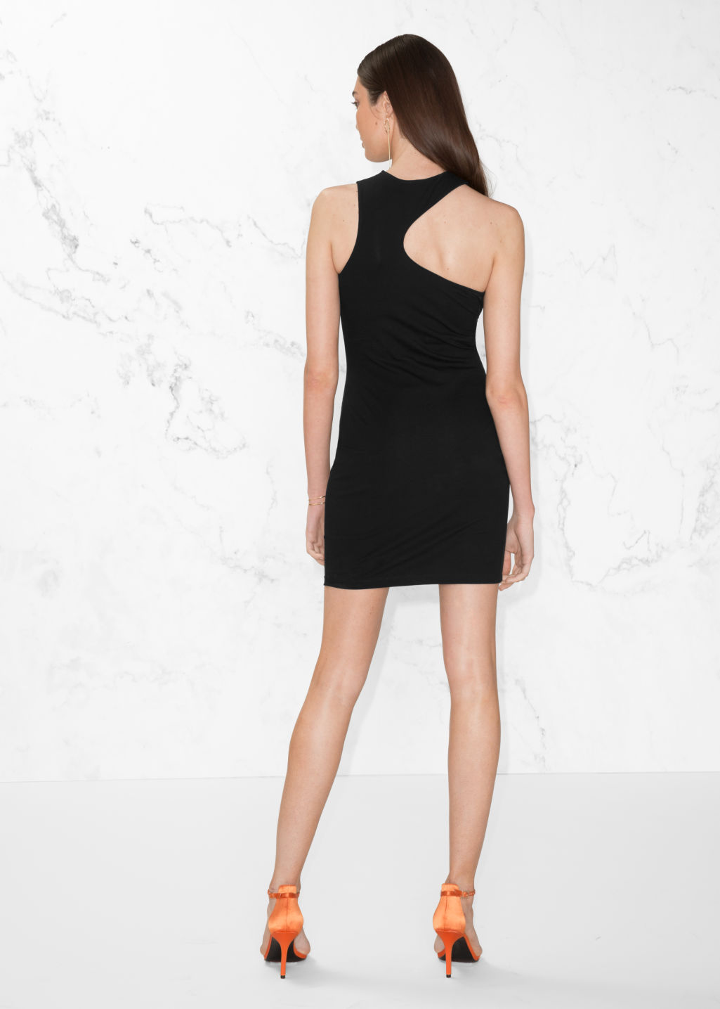 Model back image of Stories asymmetric cut-out dress in black