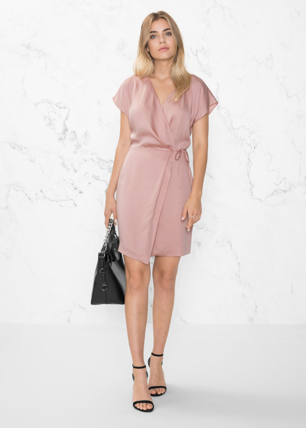 Model front image of Stories wrap dress in pink