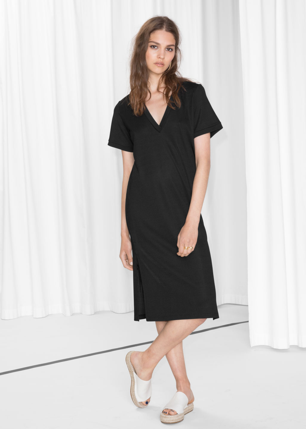 Model front image of Stories oversized t-shirt dress in black