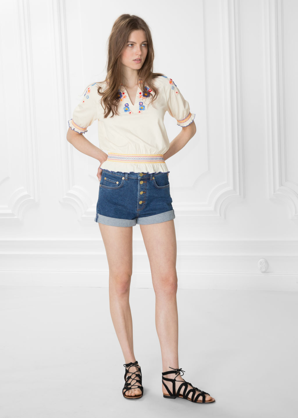 Model front image of Stories button-down denim shorts in blue