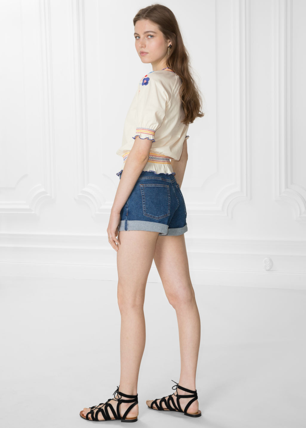 Model back image of Stories button-down denim shorts in blue