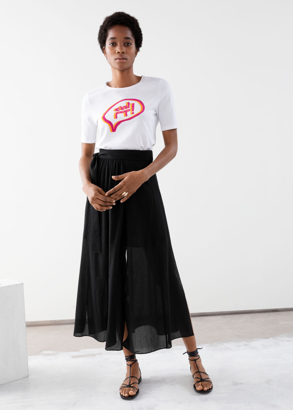 Model front image of Stories slit crepe skirt in black