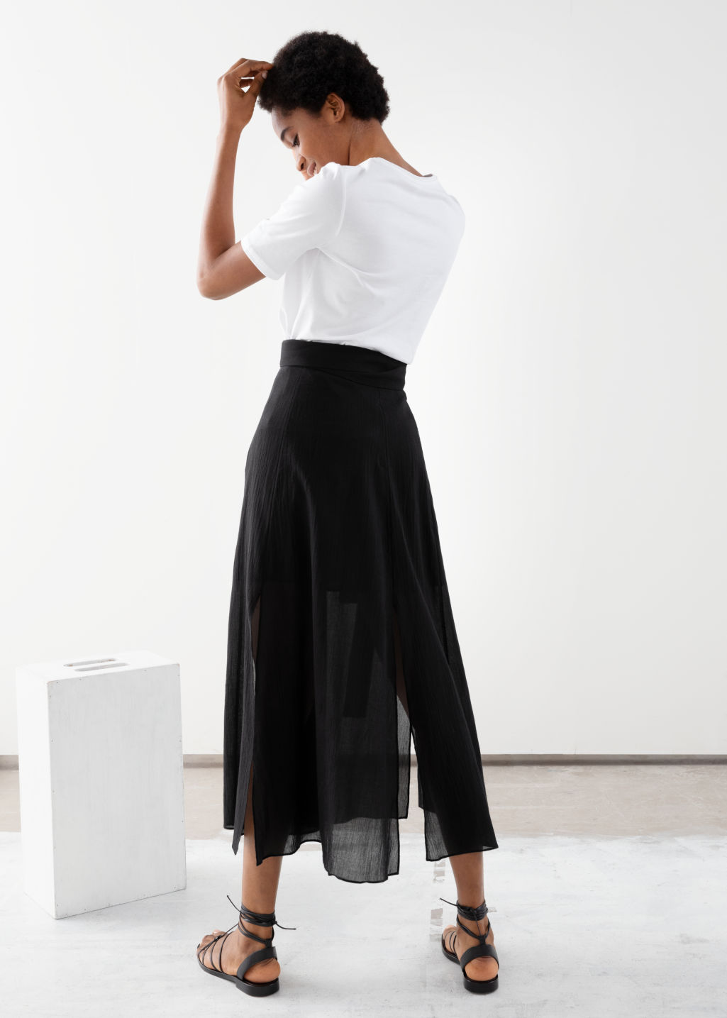 Model back image of Stories slit crepe skirt in black