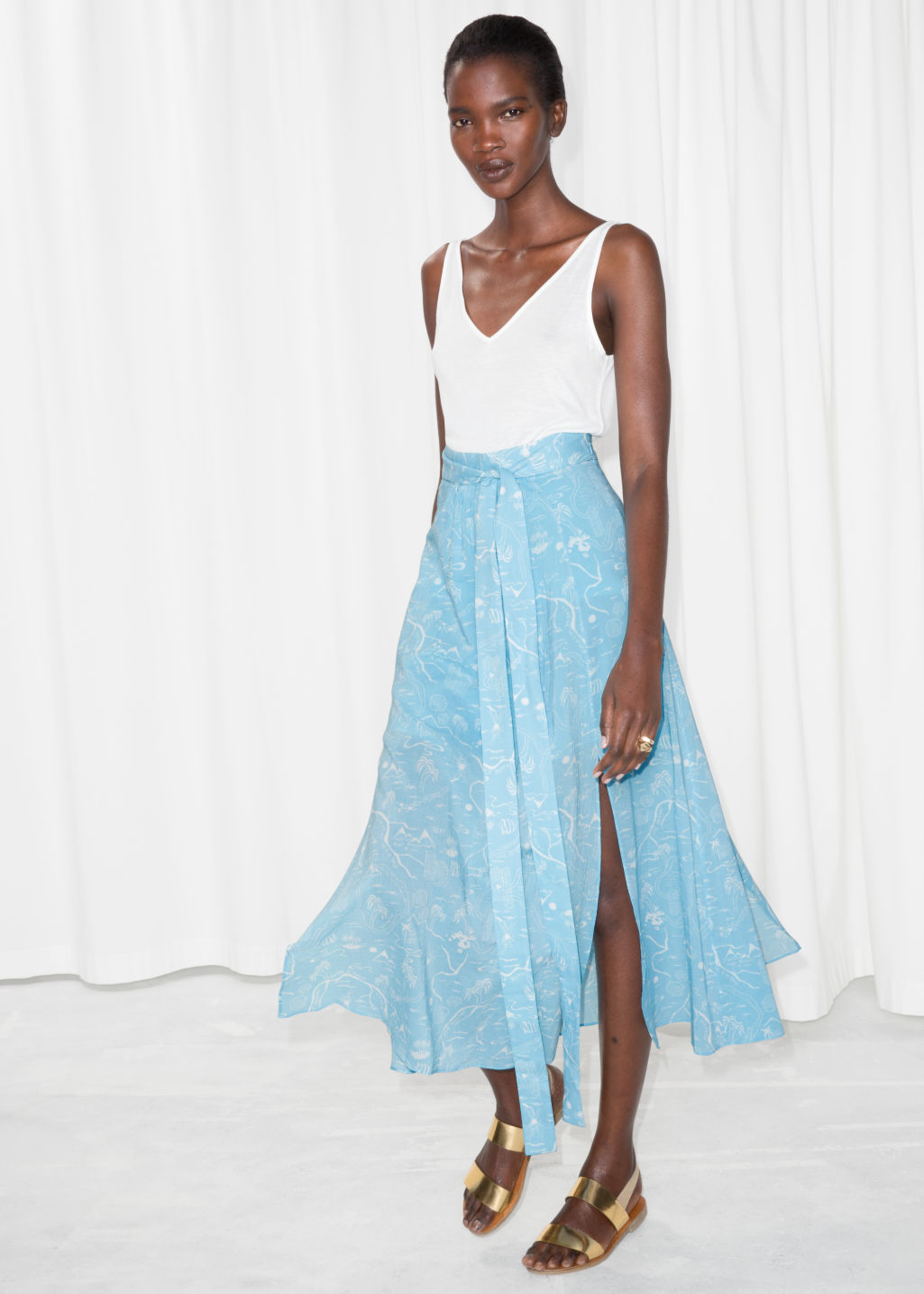 Model front image of Stories slit crepe skirt in turquoise