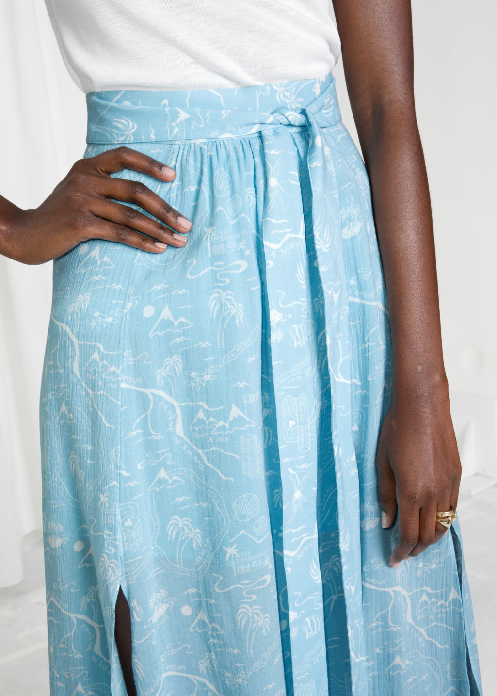 Model back image of Stories slit crepe skirt in turquoise
