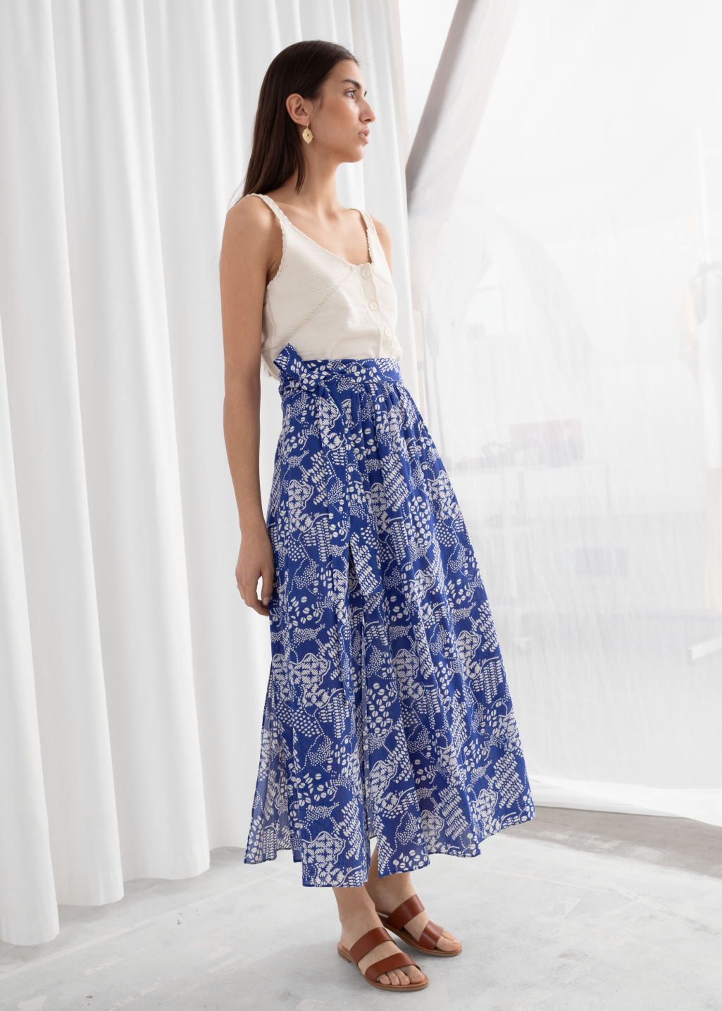 Model front image of Stories belted midi side slit skirt in blue