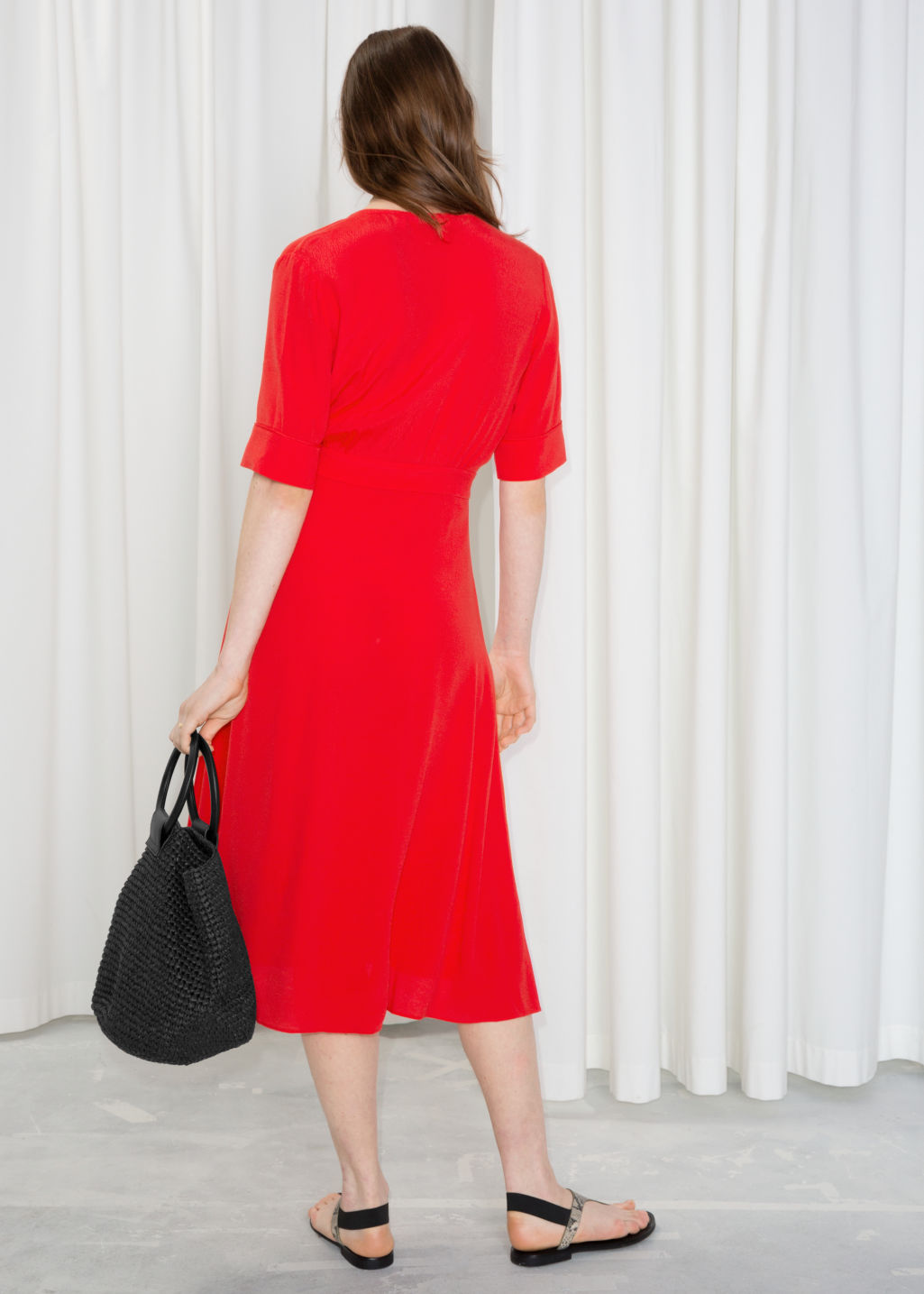 Model back image of Stories printed off shoulder dress in red