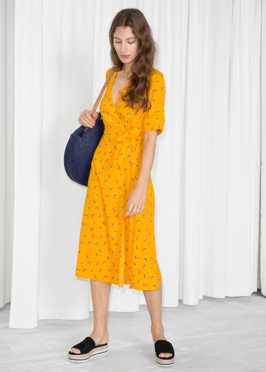 Model front image of Stories printed off shoulder dress in yellow