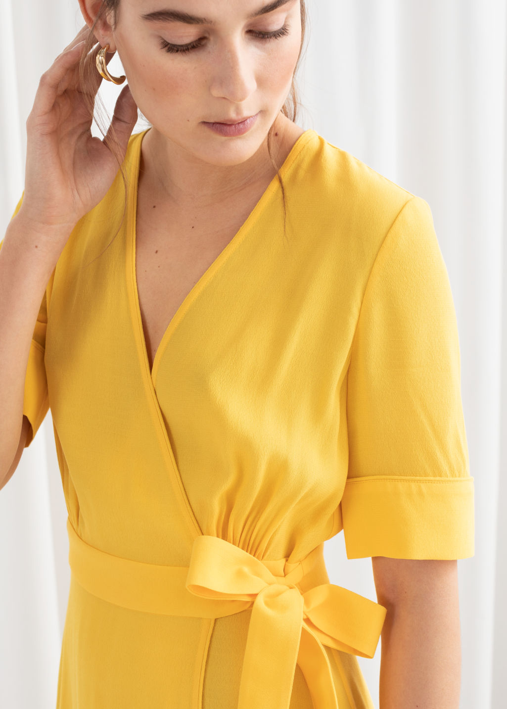 Model back image of Stories midi wrap dress in yellow