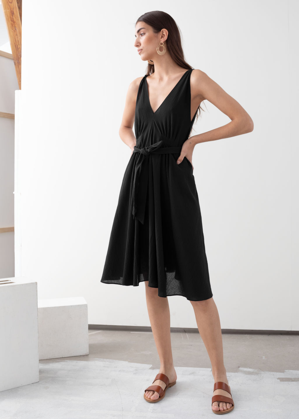 Model front image of Stories v-neck dress in black
