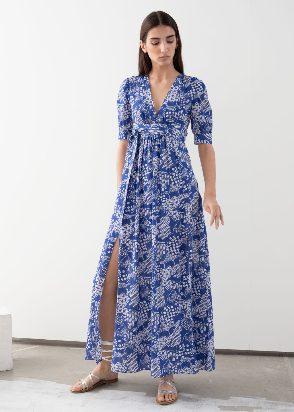 Model front image of Stories floral print midi dress in blue