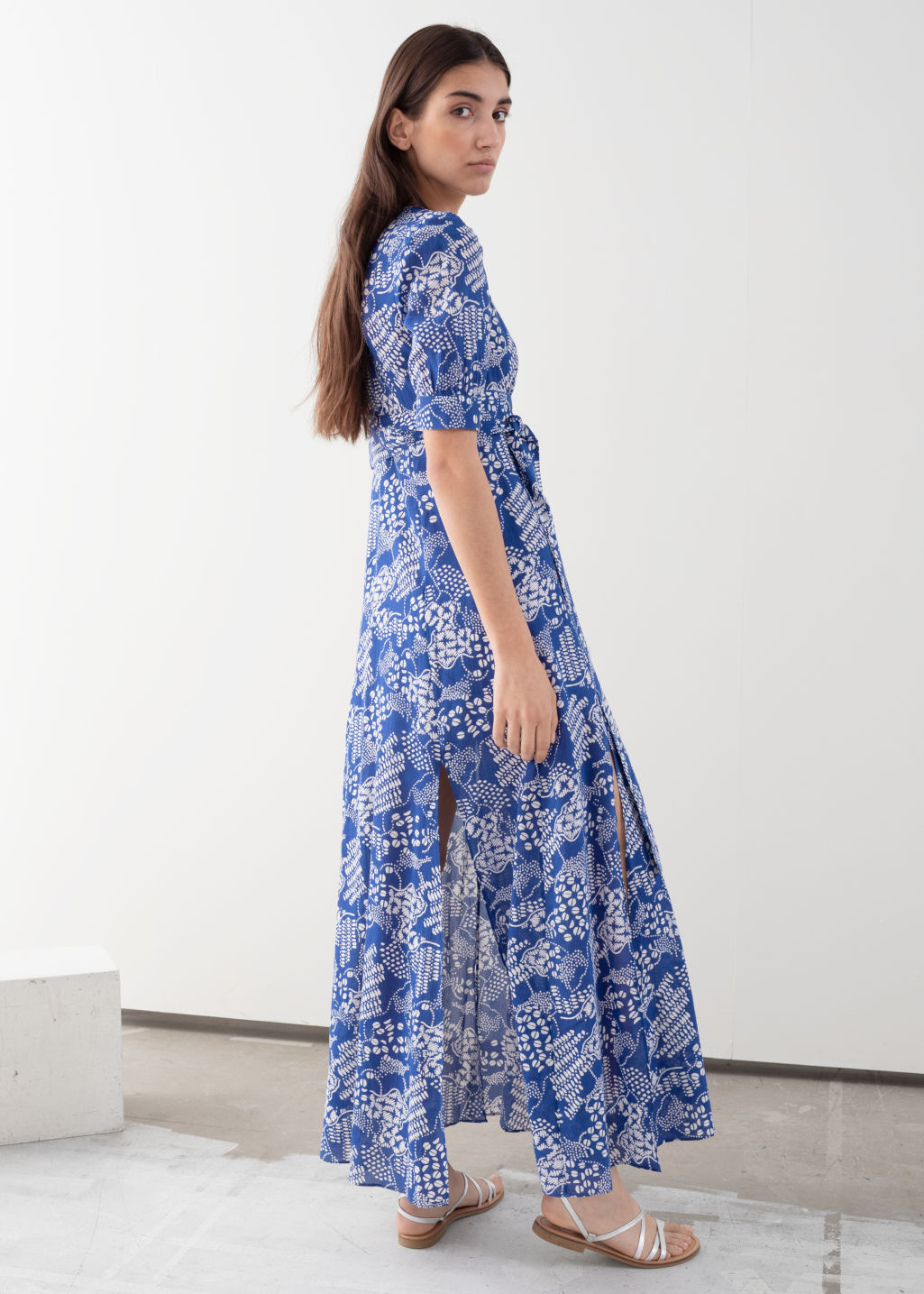 Model back image of Stories floral print midi dress in blue