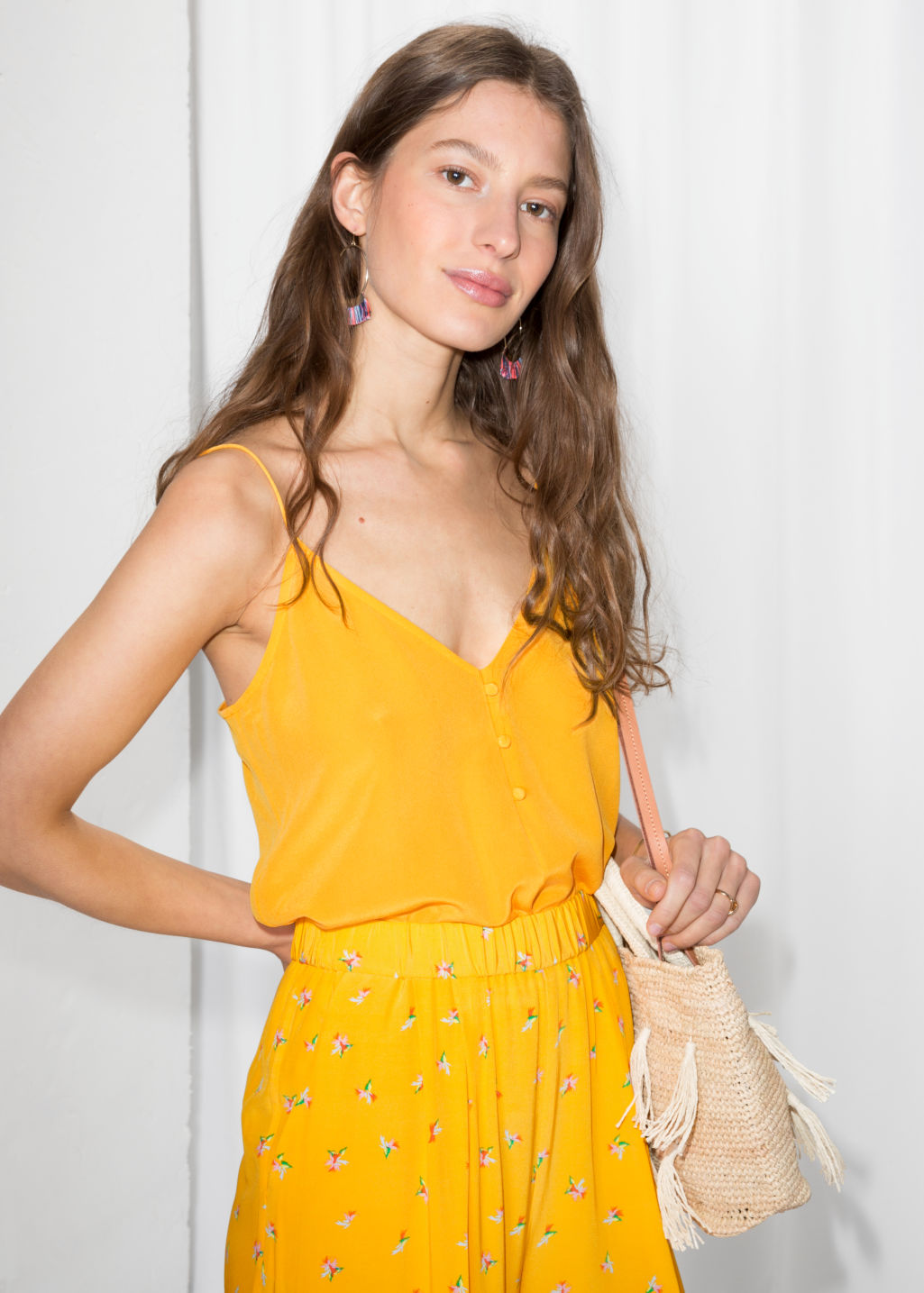 Model front image of Stories silk camisole top in yellow