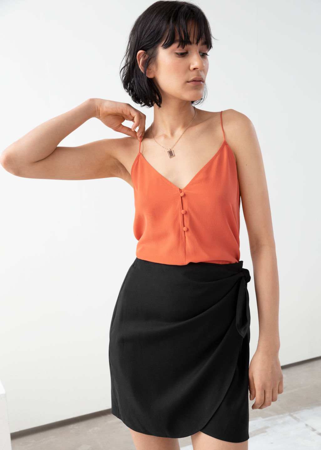 Model front image of Stories silk camisole top in orange