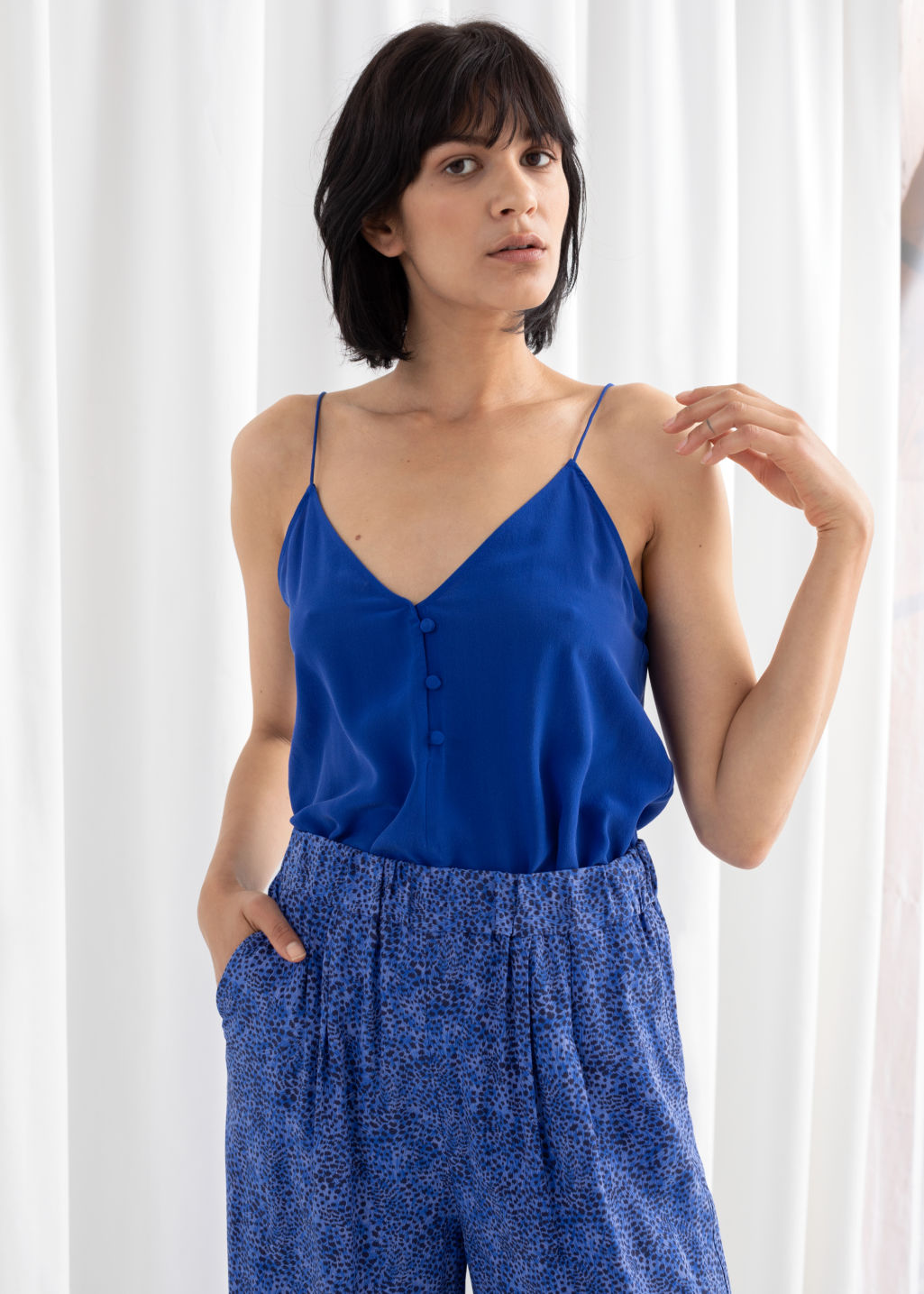 Model front image of Stories silk camisole top in blue