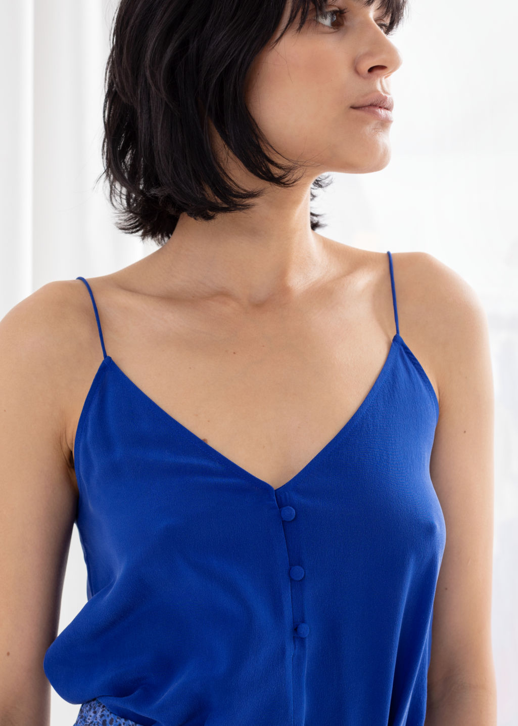 Model back image of Stories silk camisole top in blue