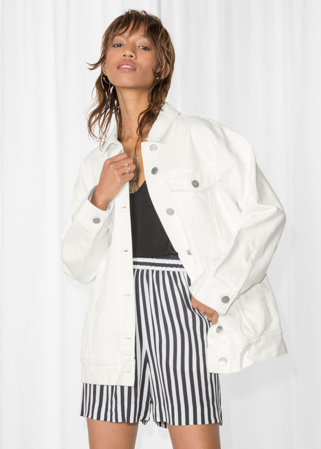 Model front image of Stories denim jacket in white