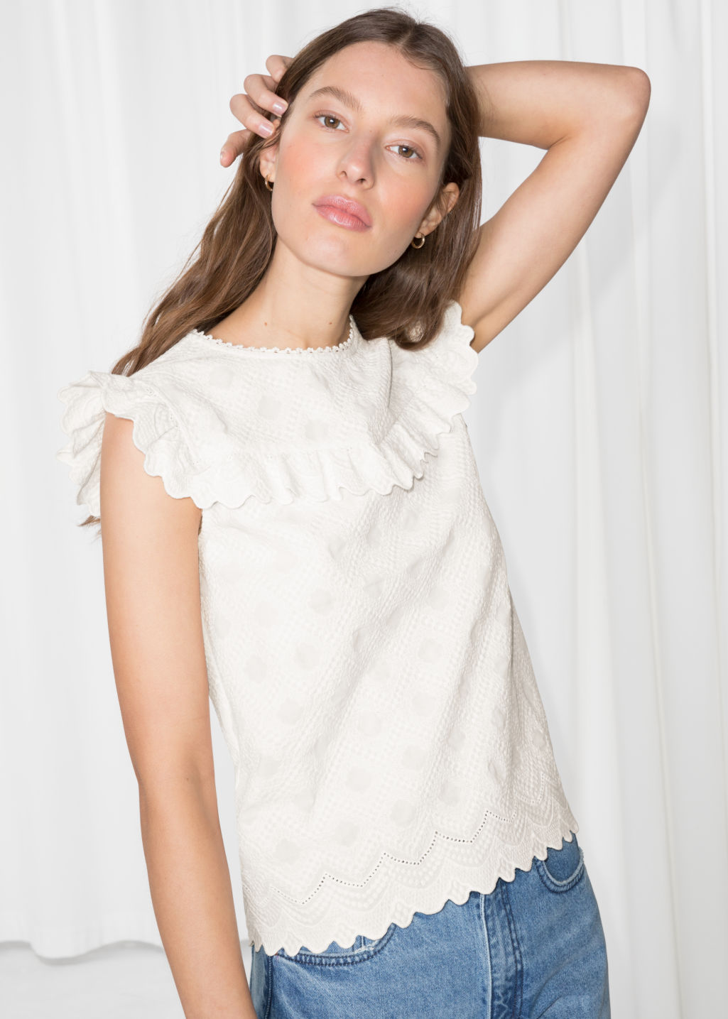 Model front image of Stories frilled sleeveless top in white