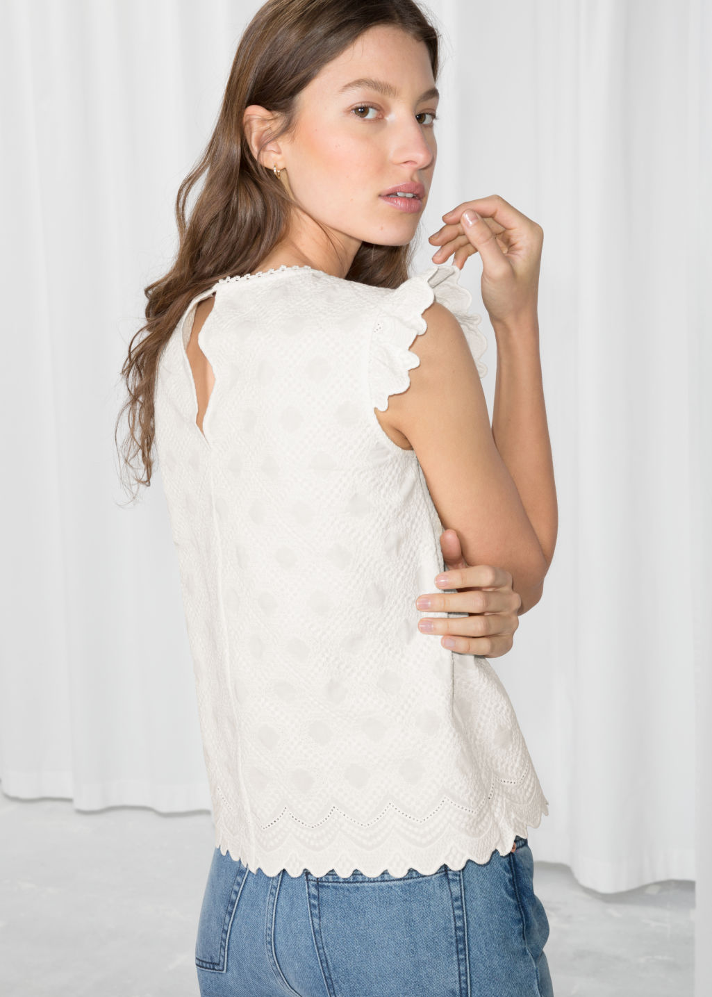 Model back image of Stories frilled sleeveless top in white
