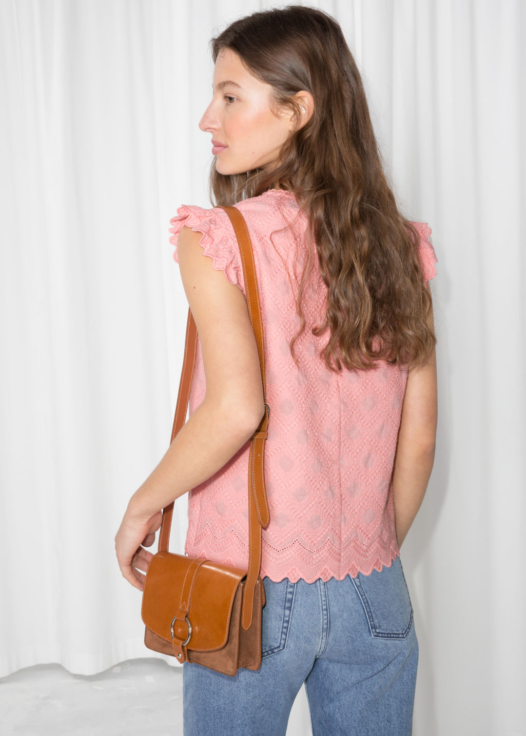 Model back image of Stories frilled sleeveless top in pink