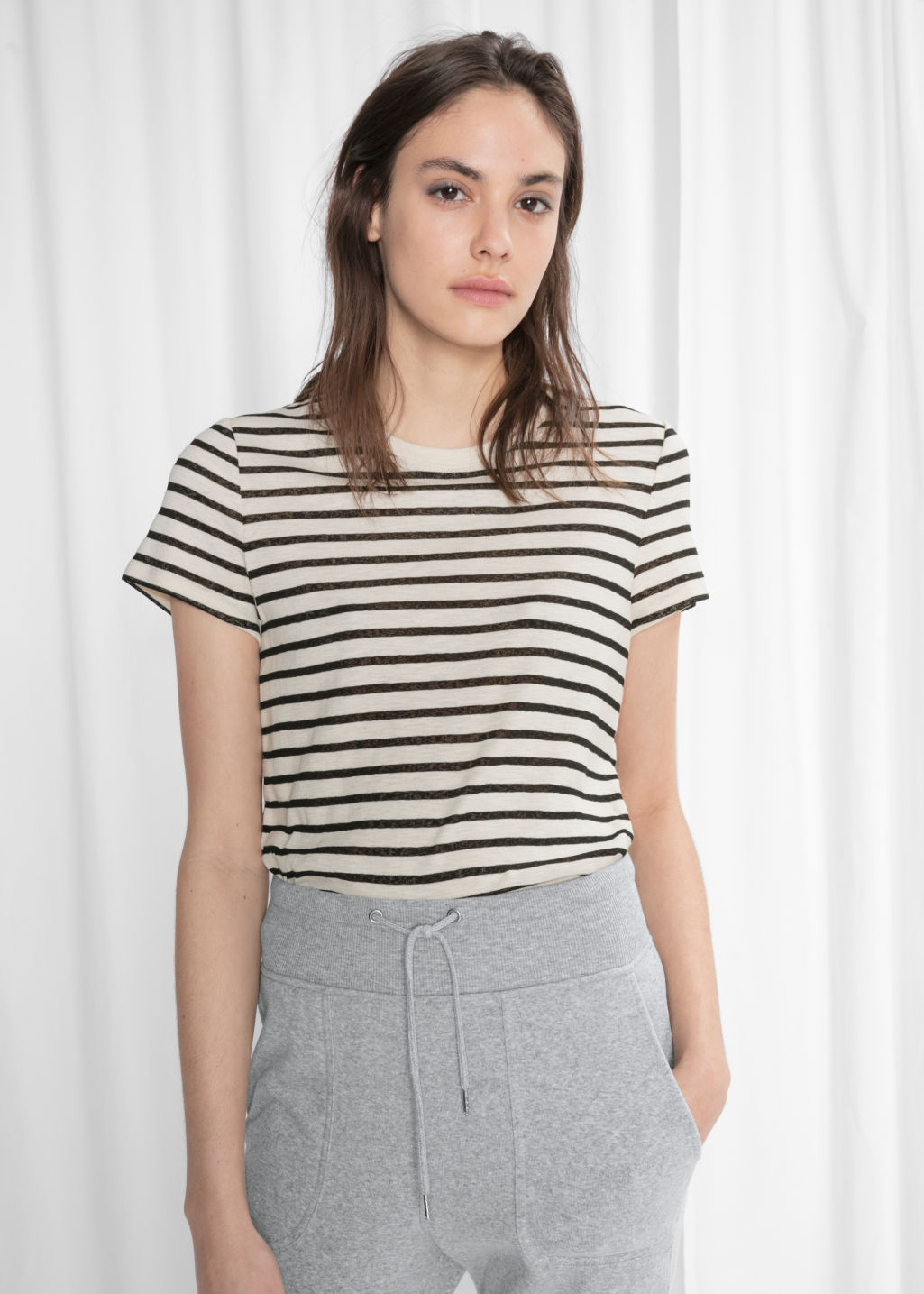 Model front image of Stories striped cotton tee in black
