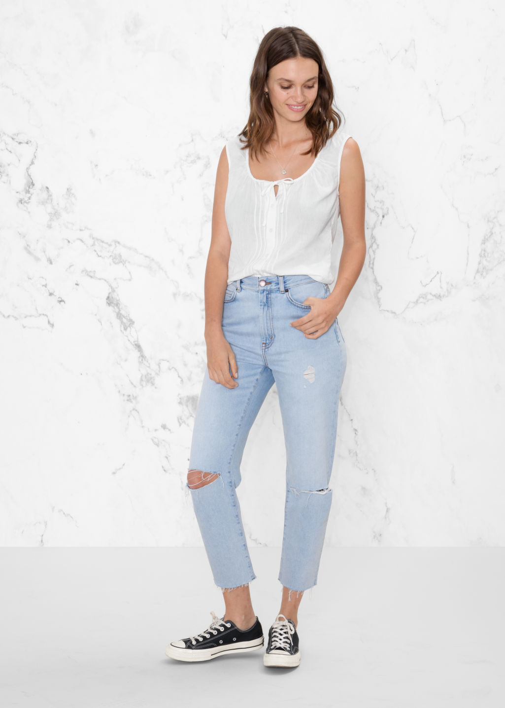 Model front image of Stories ripped denim jeans in blue