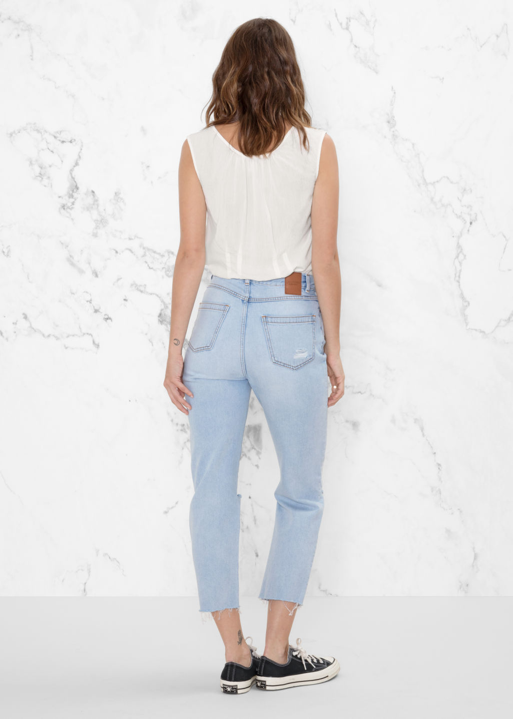 Model back image of Stories ripped denim jeans in blue