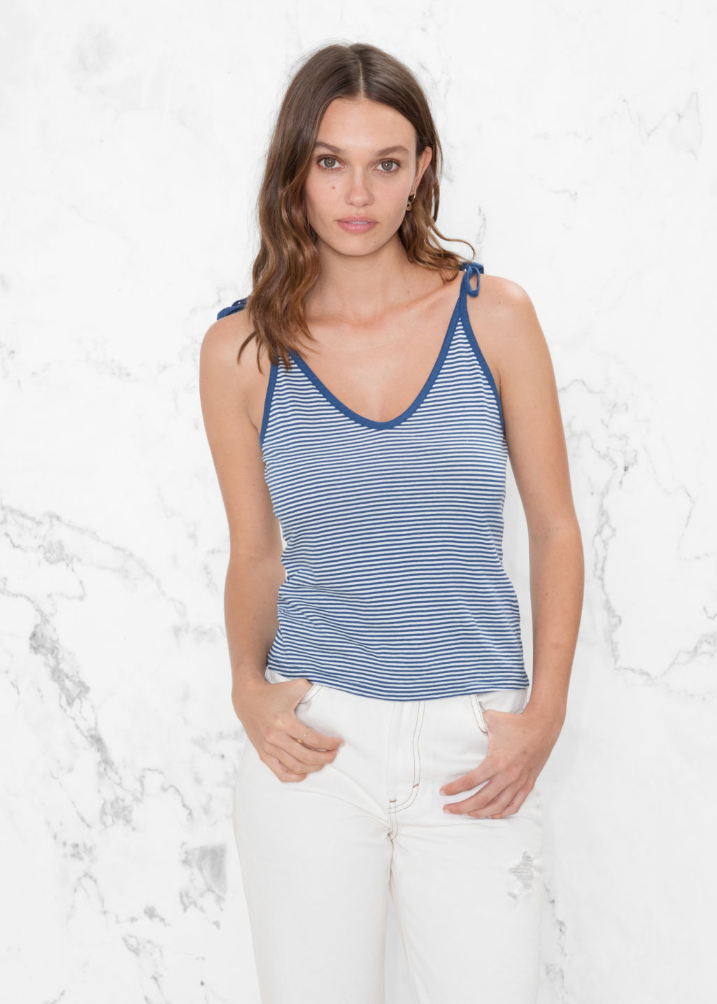 Model front image of Stories spaghetti strap top in blue