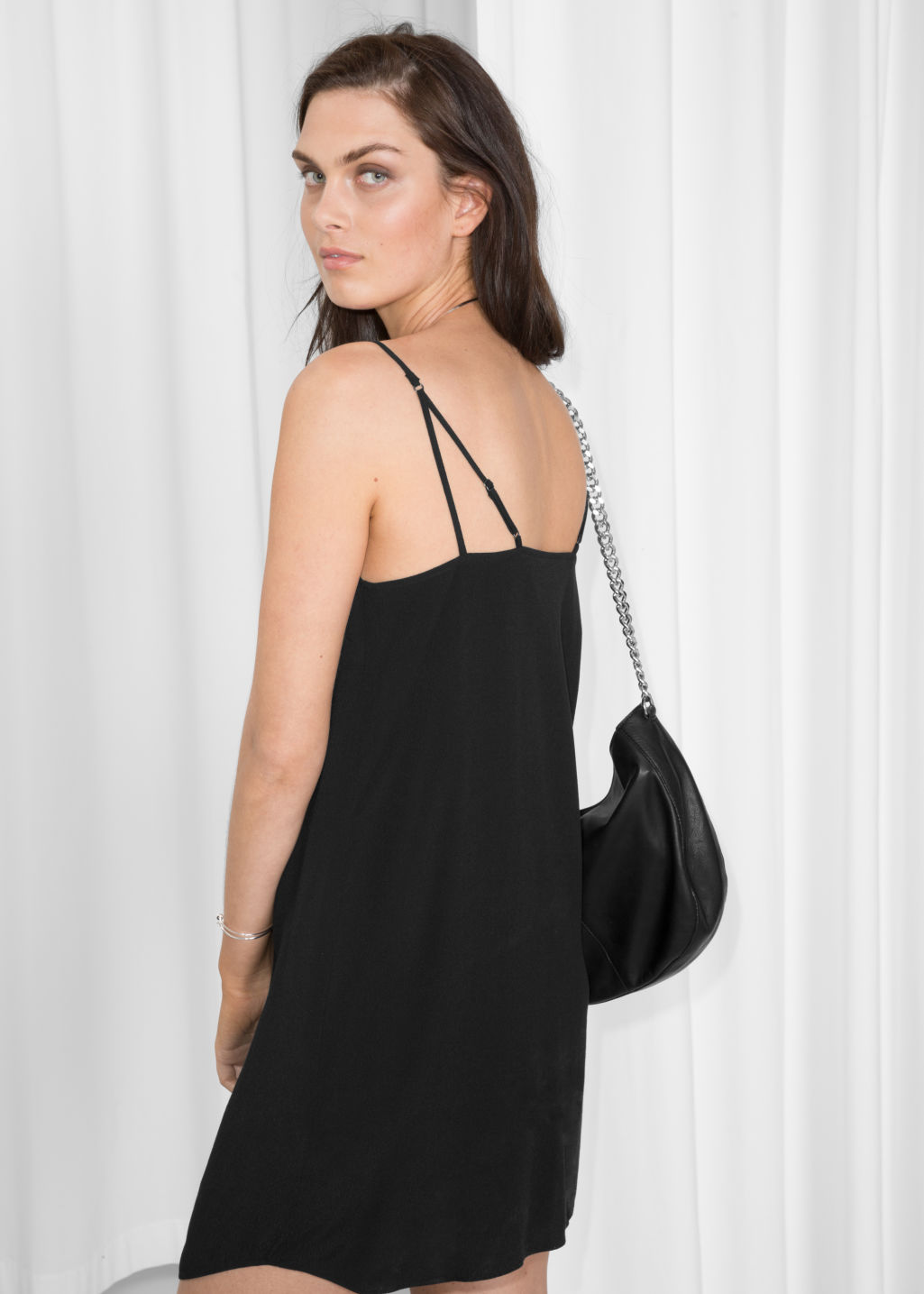 Model back image of Stories placket dress in black