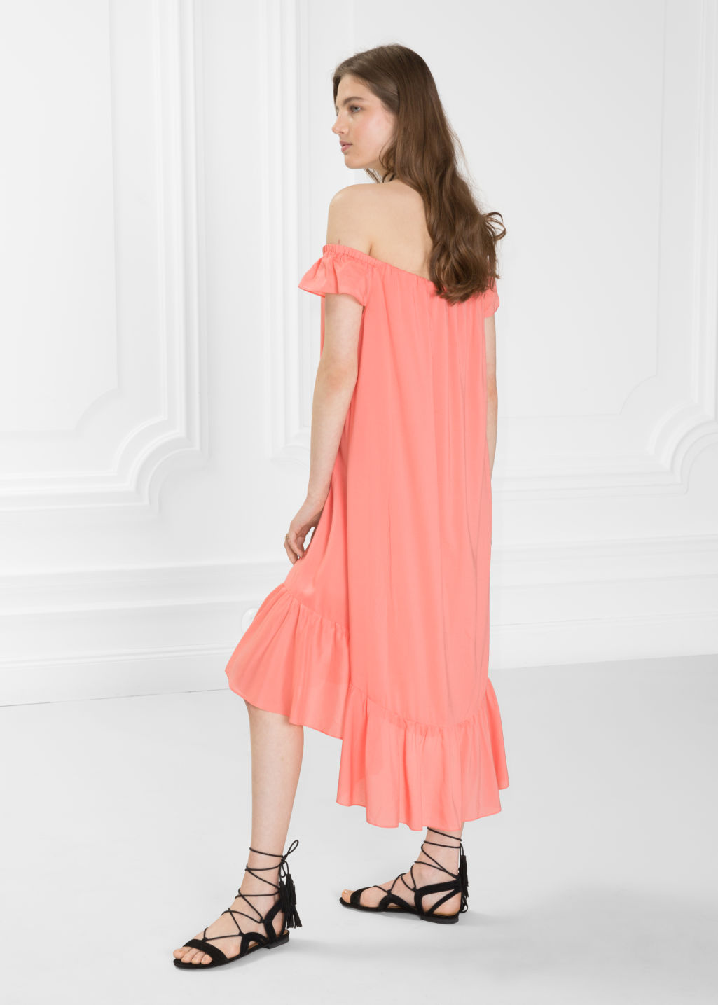 Model back image of Stories billowy off-shoulder dress in orange