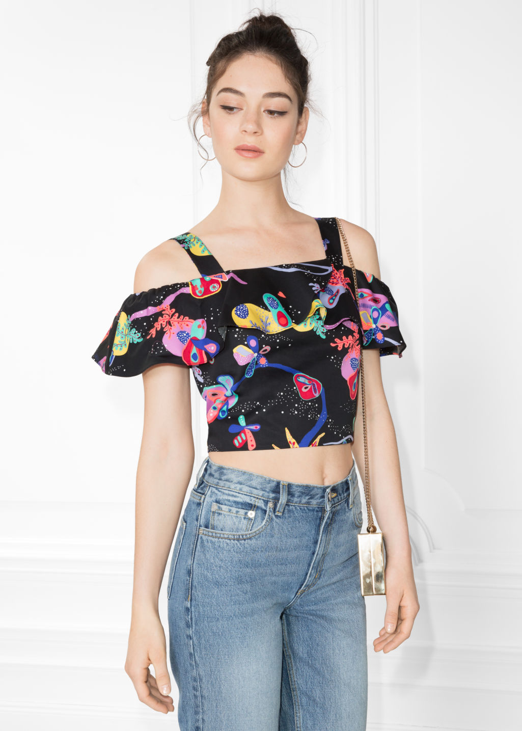 Model front image of Stories coral reef flounce top in black