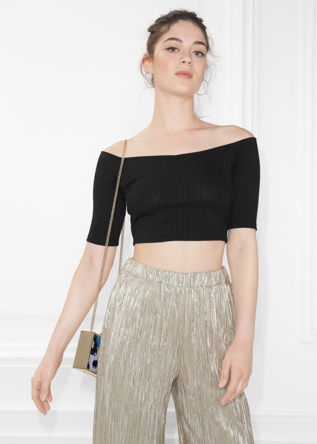 Model front image of Stories ribbed off-shoulder top in black
