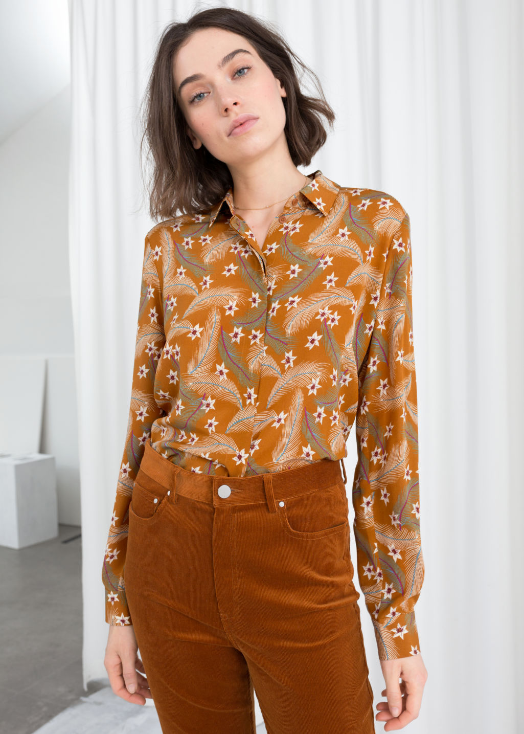 Model front image of Stories collared silk shirt in orange