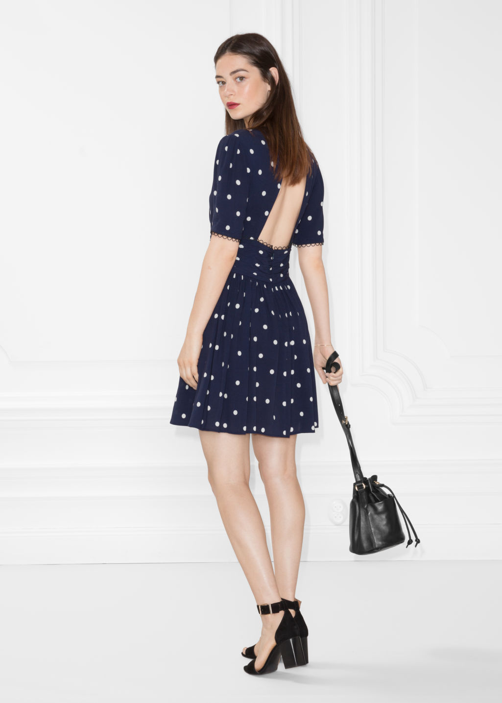 Model front image of Stories dotted dress in blue