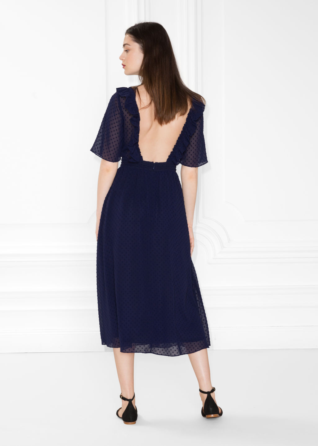 Model front image of Stories open back dotted jacquard dress in blue
