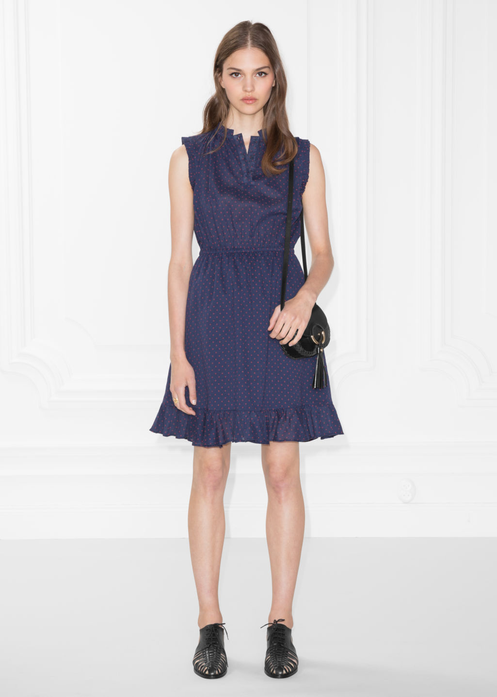Model front image of Stories sleeveless frill dress in blue