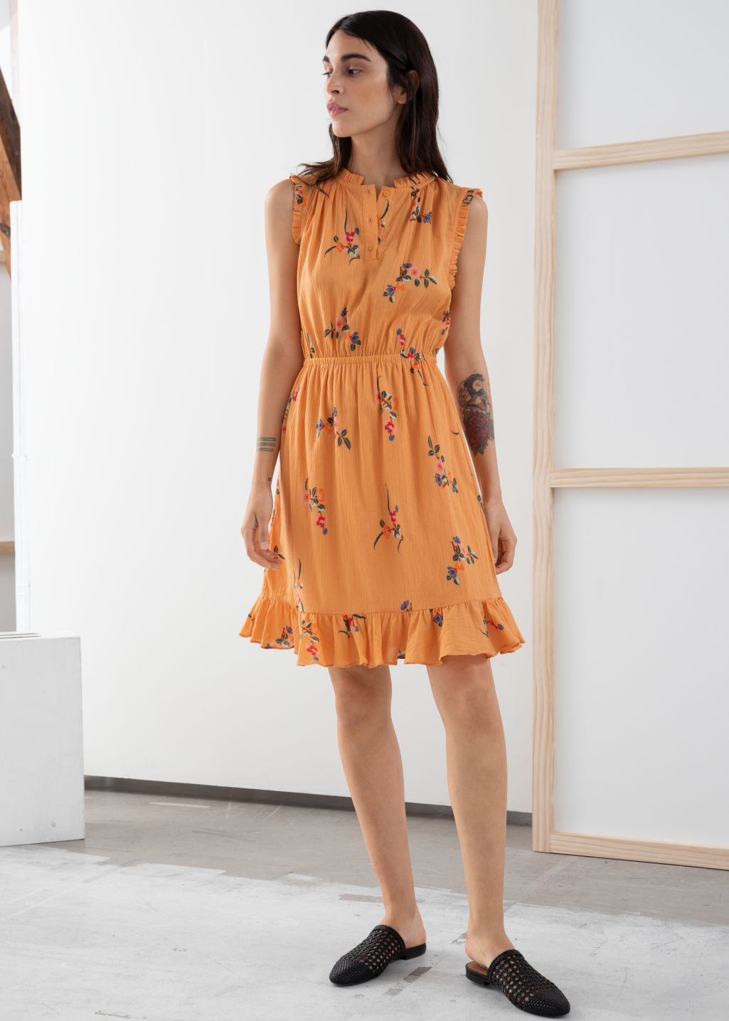 Model front image of Stories sleeveless frill dress in orange