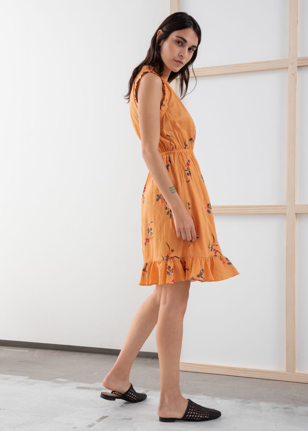 Model back image of Stories sleeveless frill dress in orange