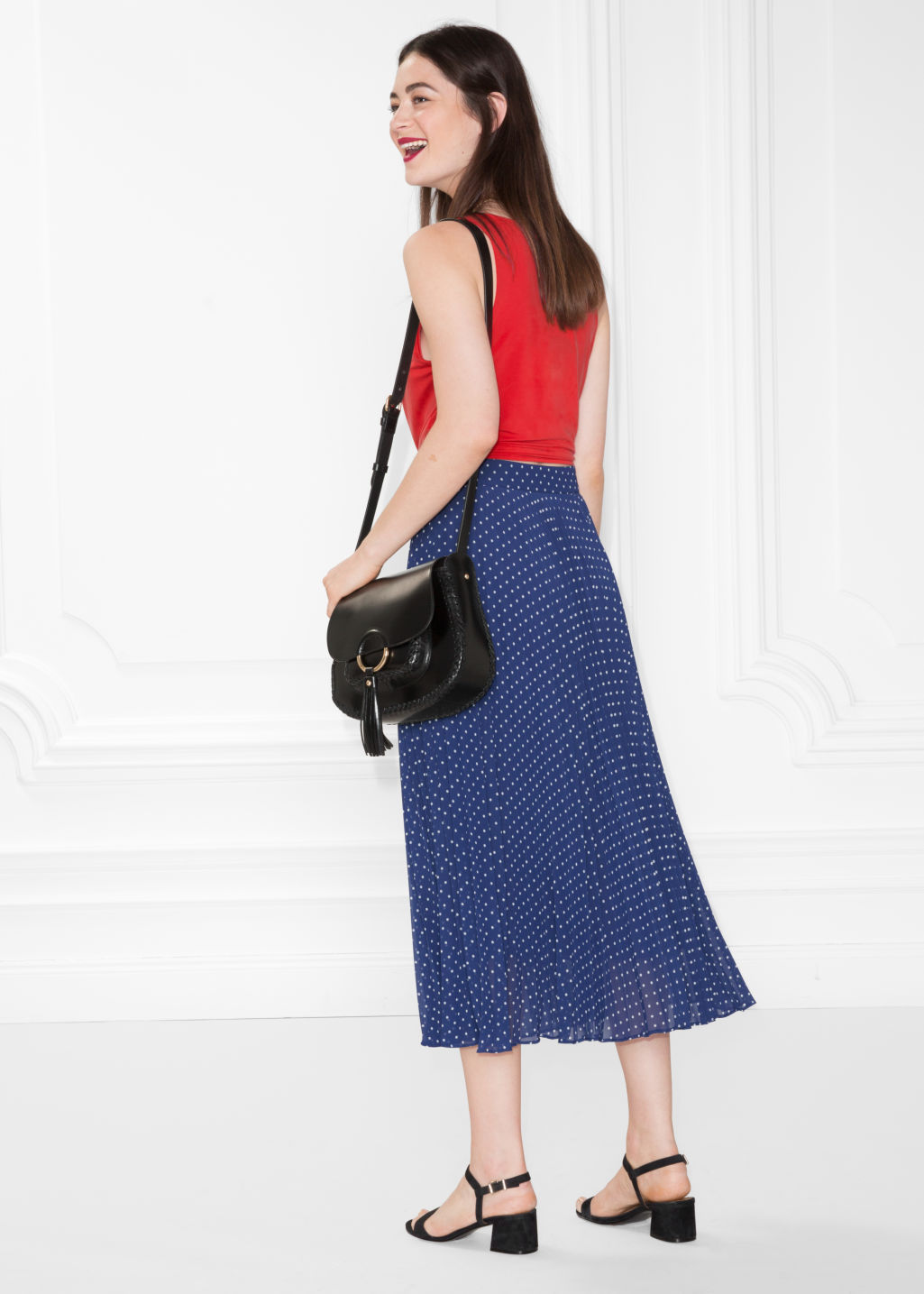Model back image of Stories pleated skirt in blue