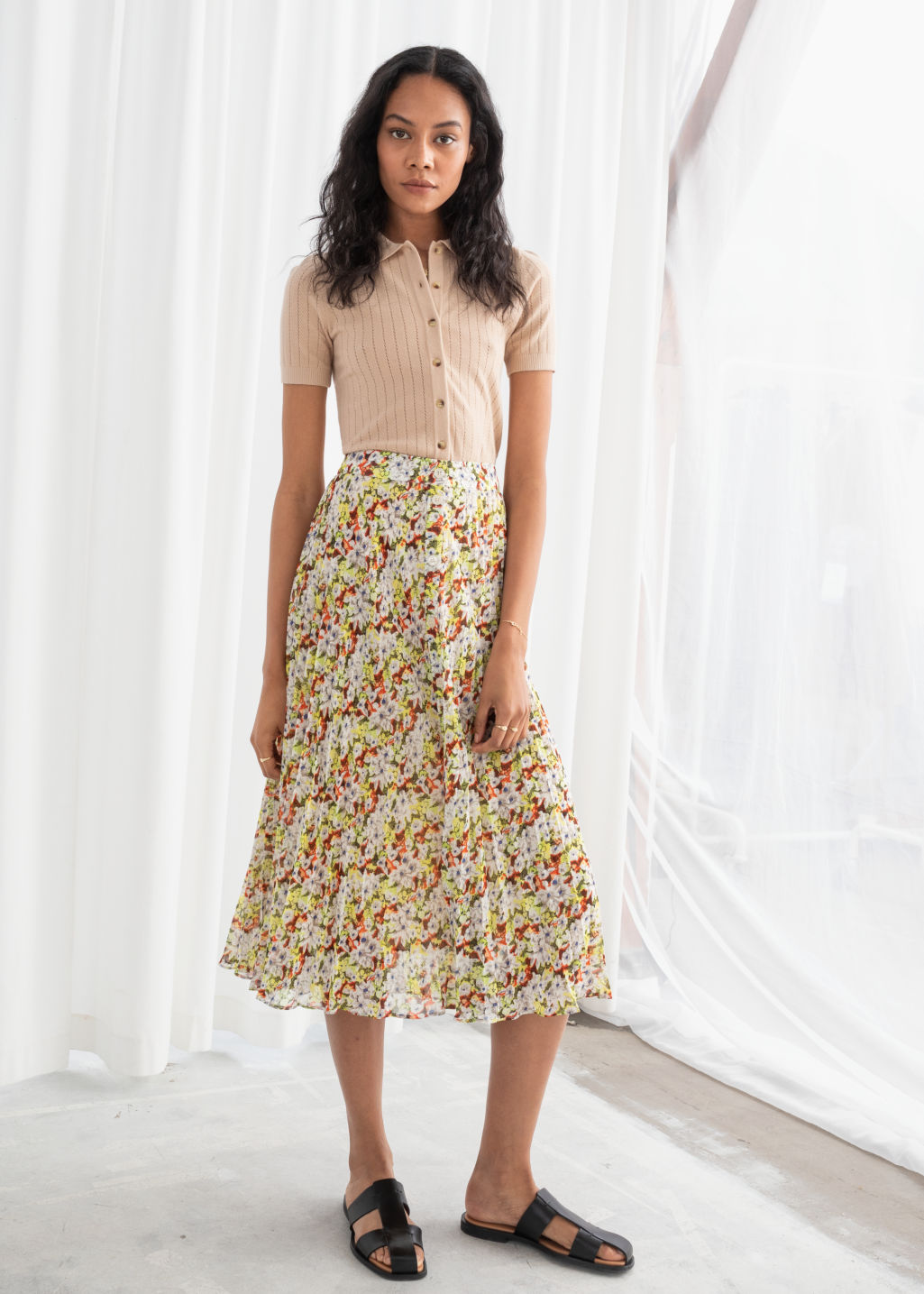 Model front image of Stories pleated midi skirt in yellow