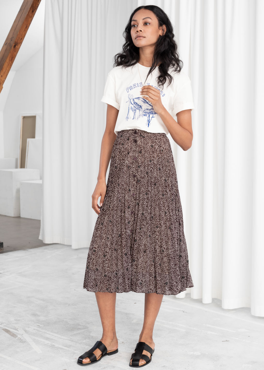 Model front image of Stories pleated midi skirt in brown