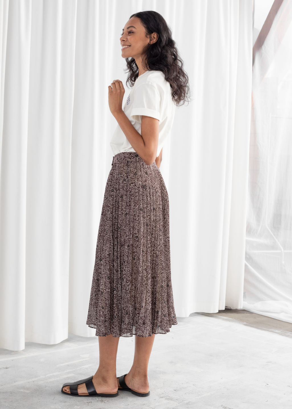 Model back image of Stories pleated midi skirt in brown