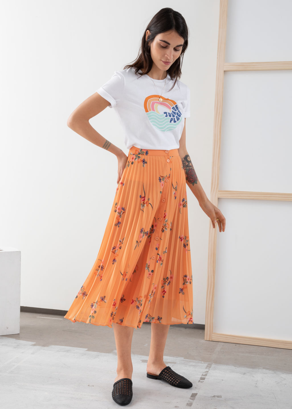 Model front image of Stories pleated midi skirt in orange