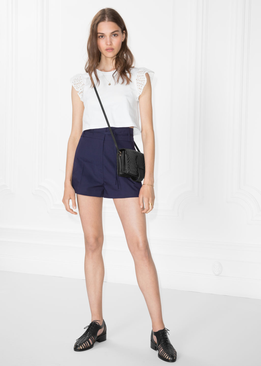 Model front image of Stories cotton shorts in blue