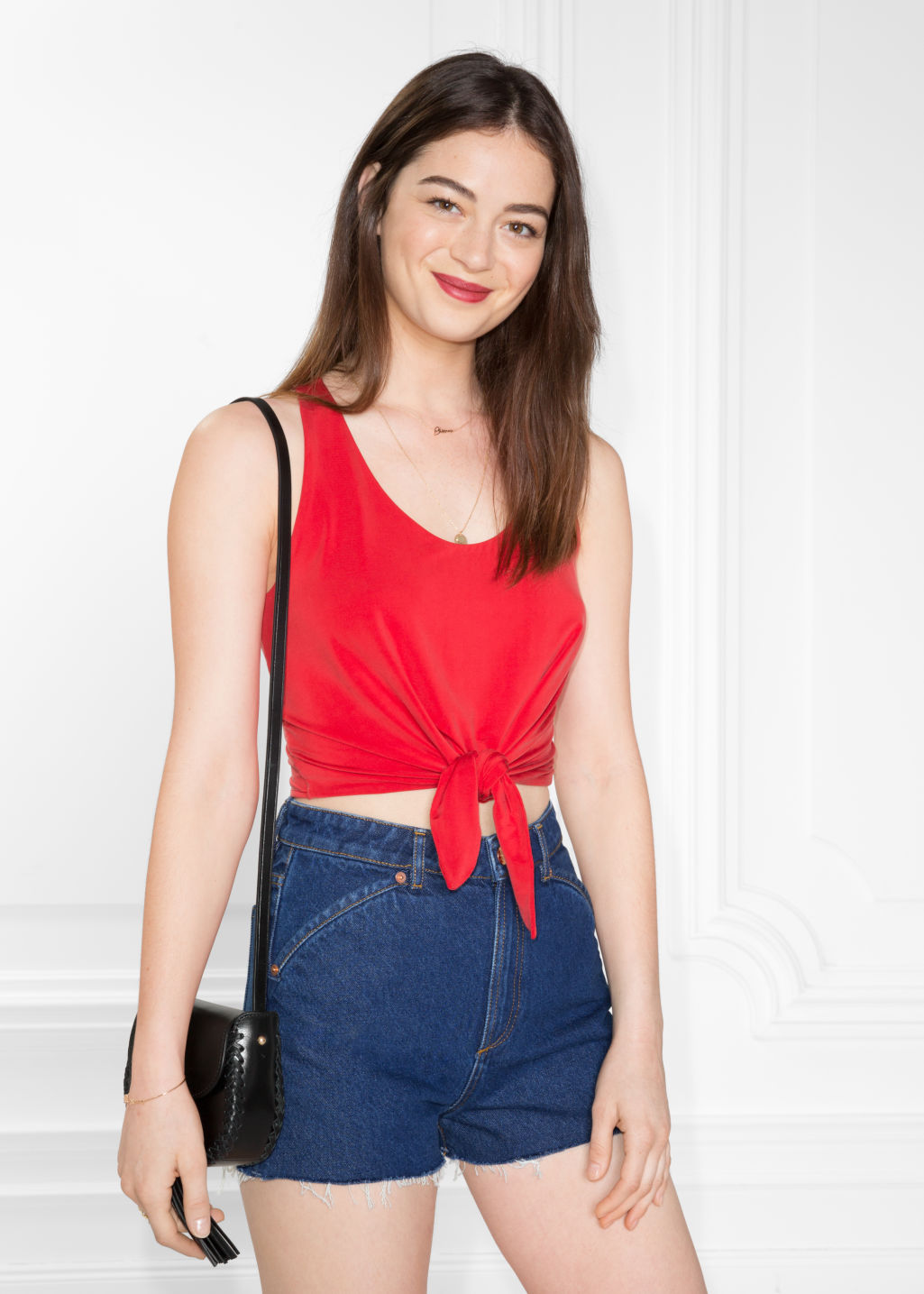 Model front image of Stories tie top in red