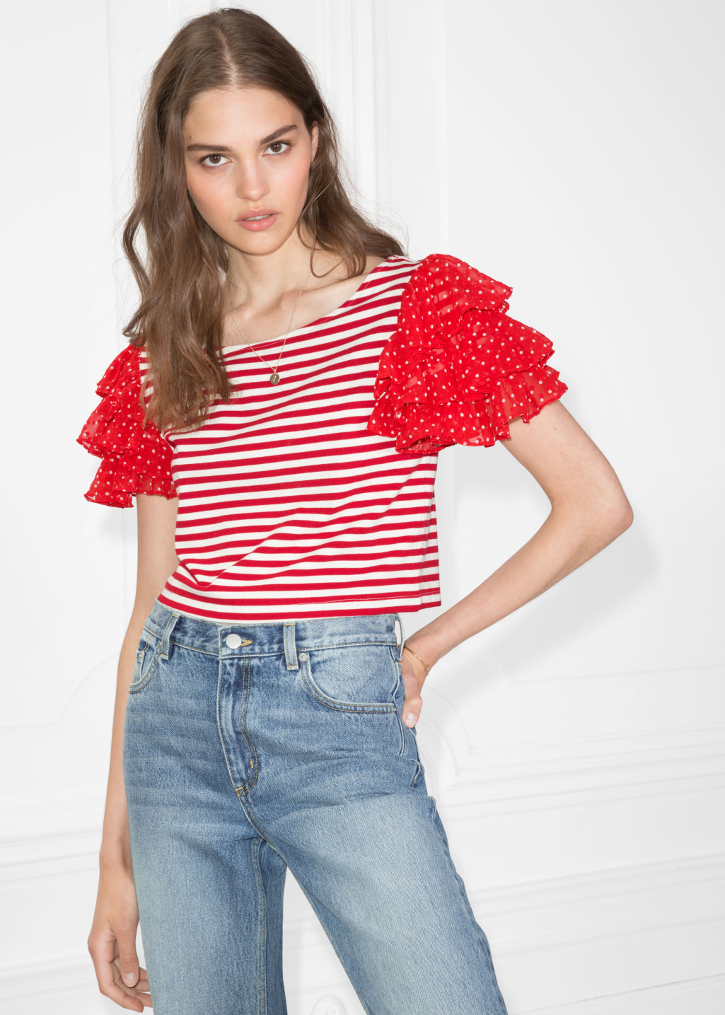 Model front image of Stories ruffle sleeve jersey top in red